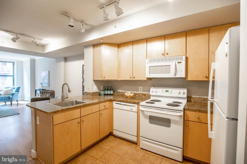 Open Kitchen with Ample Storage Space - 616 E ST NW #655, WASHINGTON
