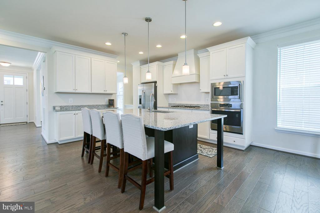 Gleaming hardwood floors and bright white kitchen - 301 PEAR BLOSSOM RD, STAFFORD