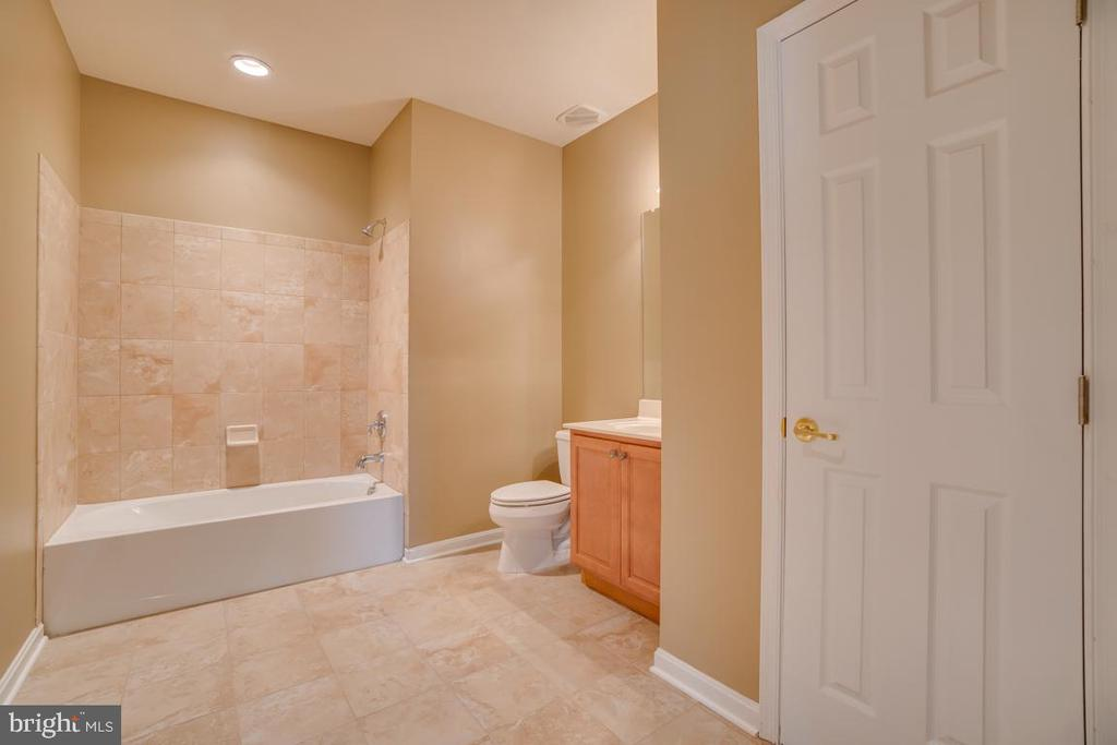 Basement bath w/ upgraded tiling and storage! - 38 JANNEY LN, FREDERICKSBURG
