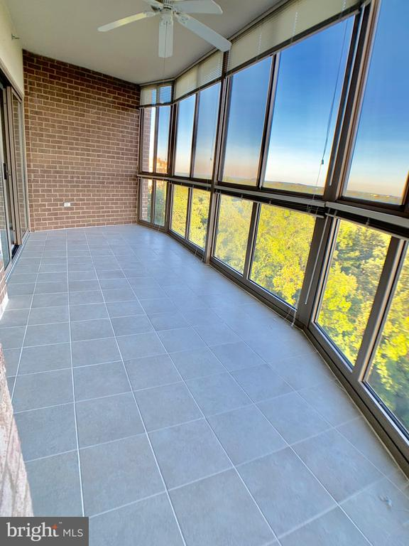 brand new ceramic tile on balcony - 19375 CYPRESS RIDGE TER #803, LEESBURG