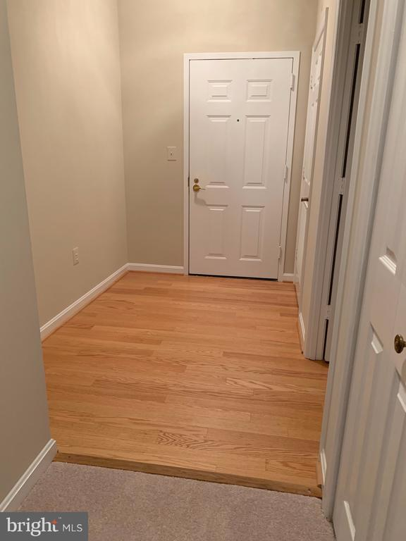 Wood foyer has room for an entry table - 19375 CYPRESS RIDGE TER #803, LEESBURG