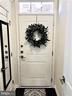 Foyer w/HW Floors , Coat Closet  & Garage  Access - 43047 STUARTS GLEN TER #105, ASHBURN