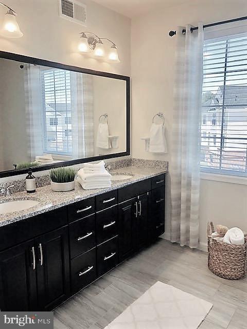 Master Bath with Double Sink Vanity and Window - 43047 STUARTS GLEN TER #105, ASHBURN