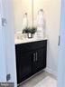 Main Level Powder Room w/Ceramic Tiled Floors - 43047 STUARTS GLEN TER #105, ASHBURN