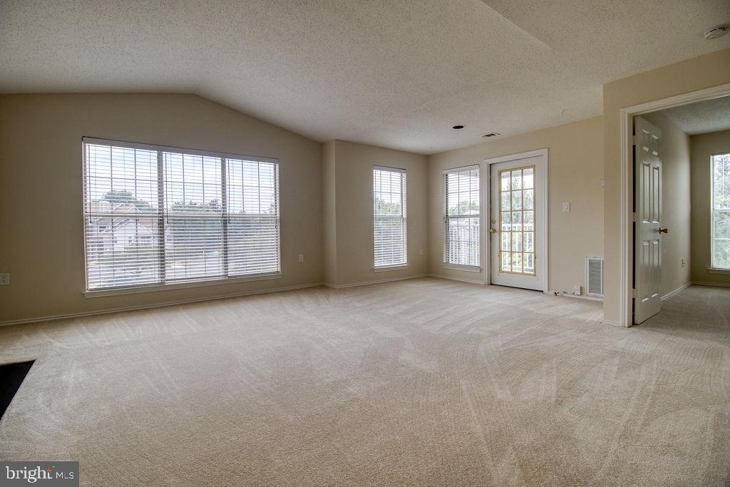 French Door Leads To Balcony From Living Room - 21024 TIMBER RIDGE TER #303, ASHBURN