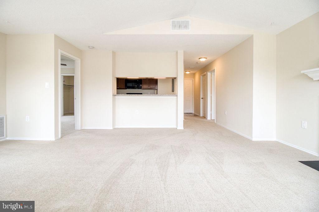 Living Room View To Kitchen - 21024 TIMBER RIDGE TER #303, ASHBURN