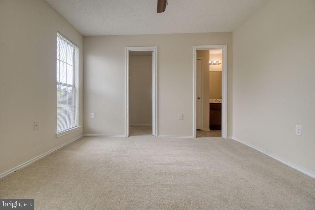 Master Bedroom With Attached Full Bathroom - 21024 TIMBER RIDGE TER #303, ASHBURN