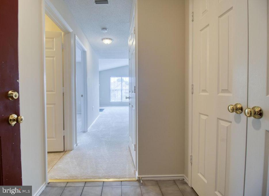 Foyer Entry To Condo With Coat Closet - 21024 TIMBER RIDGE TER #303, ASHBURN