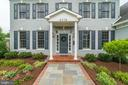 stone path to portico of brick and HardiPlank home - 6218 30TH ST N, ARLINGTON