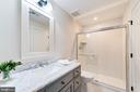 Marble topped vanity and a large shower in LL bath - 6218 30TH ST N, ARLINGTON