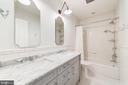 upstairs hall bath with tub double bowl vanity - 6218 30TH ST N, ARLINGTON