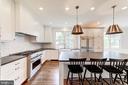 concealed range hood and glazed tile backsplash - 6218 30TH ST N, ARLINGTON