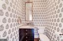 sophisticated powder room with appealing wallpaper - 6218 30TH ST N, ARLINGTON
