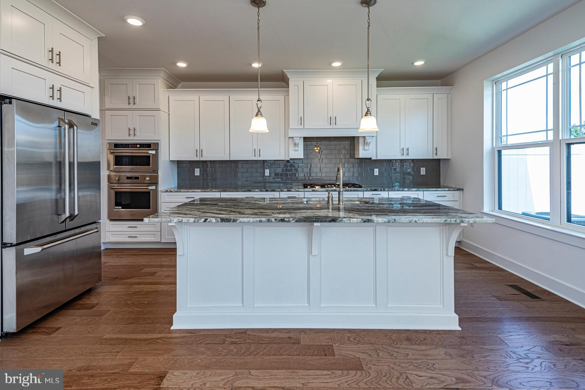 Photo's are from similar unit.  Open Kitchen