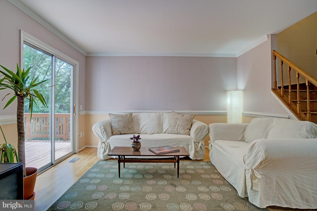 Spacious living area leads to deck - 5994 POWELLS LANDING RD, BURKE