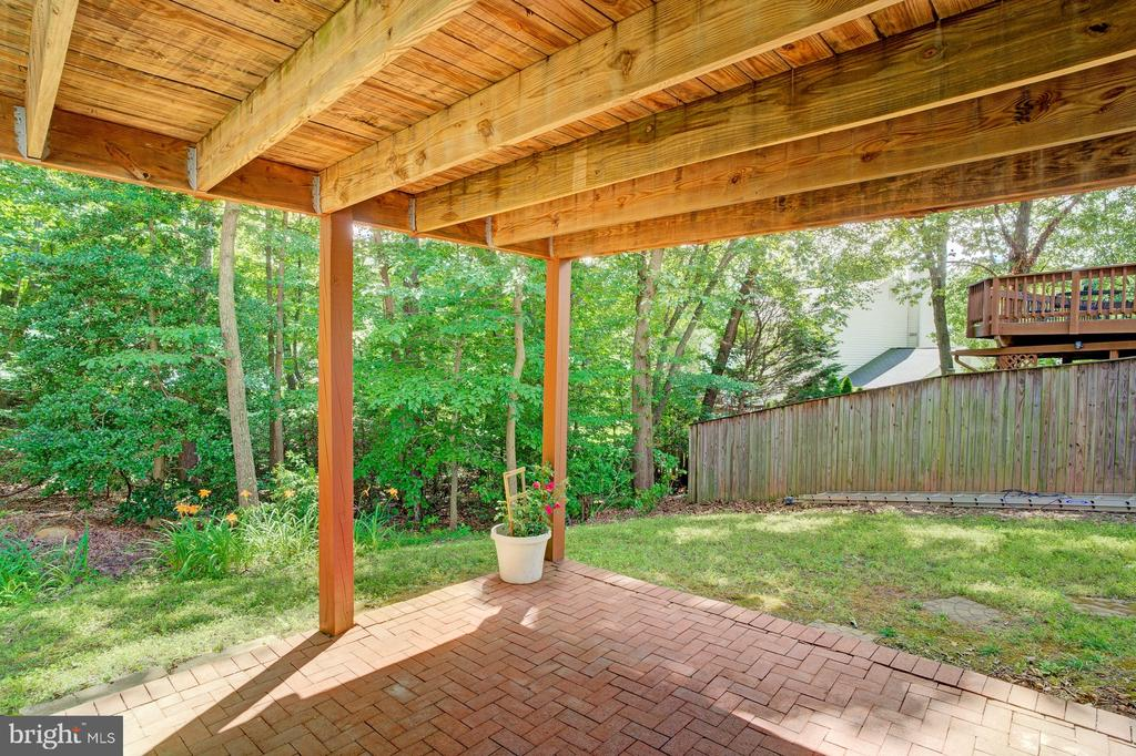 Lower level walk out brick patio - 5994 POWELLS LANDING RD, BURKE