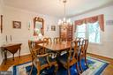 Hardwood floors and a view of trees from window - 4621 TAPESTRY DR, FAIRFAX