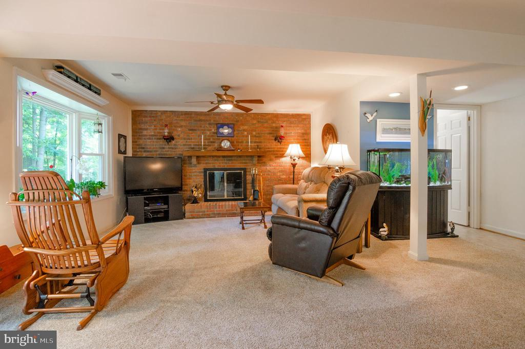 Family room has a cozy wood burning fireplace - 4621 TAPESTRY DR, FAIRFAX