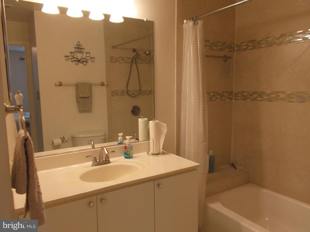 Nice lighting in bathroom! - 20602 CORNSTALK TER #102, ASHBURN