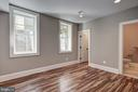 walk-in closet and large windows in 5th LL bedroom - 2320 N VERNON ST, ARLINGTON