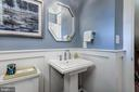 powder room with wainscoting tucked off foyer - 2320 N VERNON ST, ARLINGTON