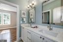 double bowl vanity in shared bathroom with tub - 2320 N VERNON ST, ARLINGTON