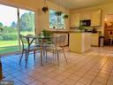 Eat in kitchen, slider to the backyard. - 9202 MATTHEW DR, MANASSAS PARK