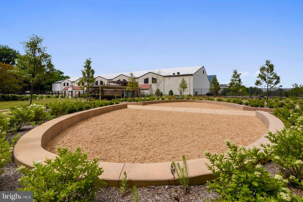 New landscaped rear patio area - 1800 OLD MEADOW RD #621, MCLEAN