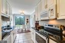 Kitchen with new stainless appliances - 1800 OLD MEADOW RD #621, MCLEAN