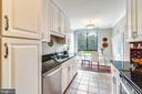 Kitchen with pantry closet - 1800 OLD MEADOW RD #621, MCLEAN