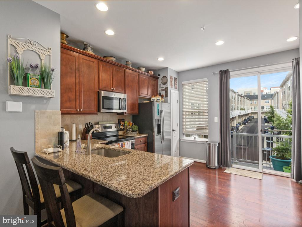 Open Floor Plan Kitchen with Granite Countertops - 613 BARNES ST NE, WASHINGTON