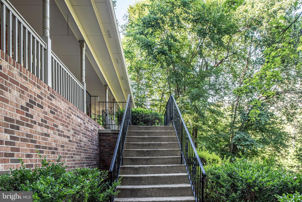 Wrought iron railing leading to front porch. - 35 GREEN LEAF TER, STAFFORD