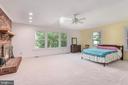 Master bedroom ceiling fan, fireplace. - 35 GREEN LEAF TER, STAFFORD