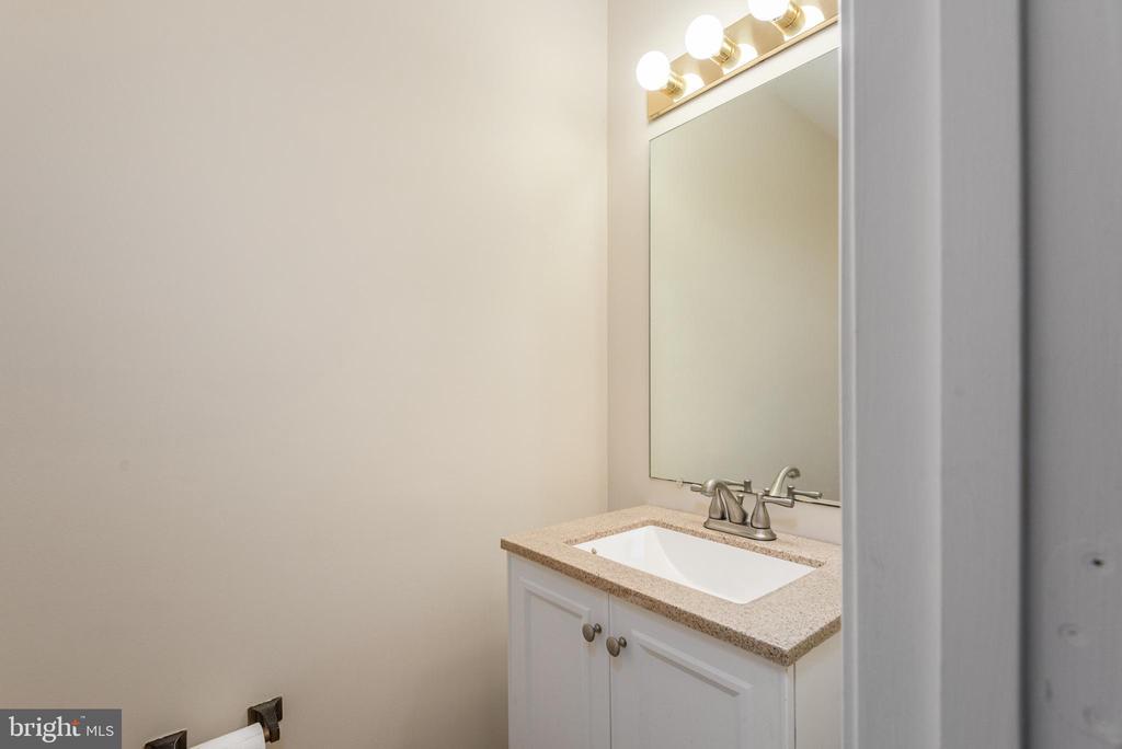 Hall half bath  granite vanity and new flooring. - 35 GREEN LEAF TER, STAFFORD