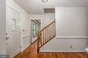 Large foyer with chair railing and wood flooring. - 35 GREEN LEAF TER, STAFFORD