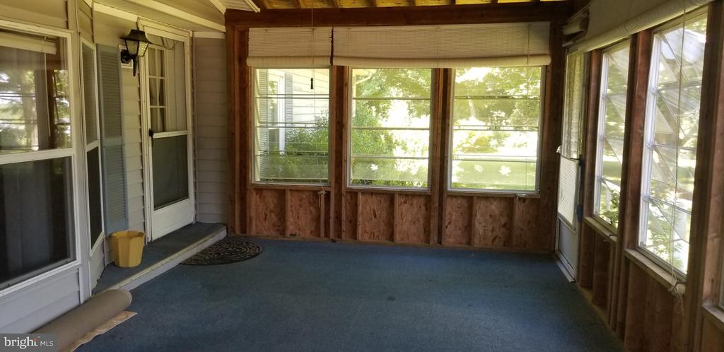 Screened front porch - 31837 ZOAR RD, LOCUST GROVE