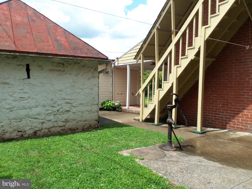 Patio and side lawn showing Apt. C upstairs entry - 120 N MAPLE AVE, MARTINSBURG