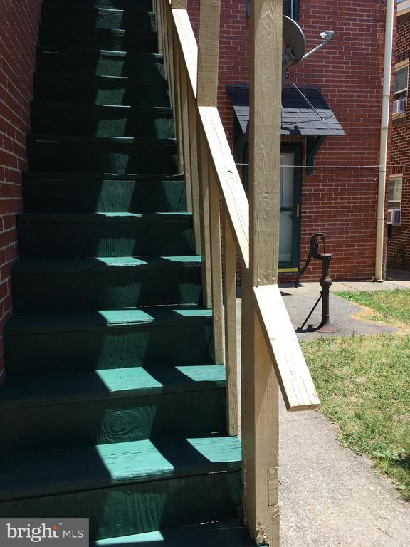Staircase to Apt. C with Apt. B Entry Door in back - 120 N MAPLE AVE, MARTINSBURG