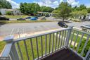 Private balcony overlooks green space and parking. - 24 SIMEON LN, STERLING