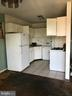 Kitchen with Gas range - 5851 QUANTRELL AVE #407, ALEXANDRIA