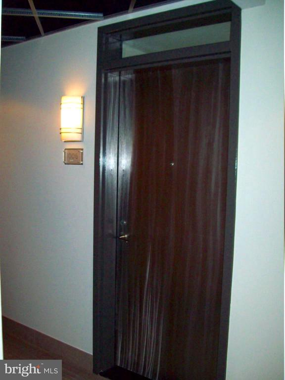 Unit door from hallway - 1133 14TH ST NW #1006, WASHINGTON