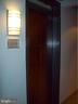 exterior view of unit door near elevators - 1133 14TH ST NW #1006, WASHINGTON