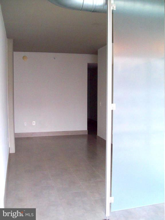 view of bedroom from lvgrm. Closet entry visible - 1133 14TH ST NW #1006, WASHINGTON