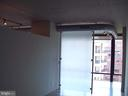 another view of bedroom, concrete ceilings - 1133 14TH ST NW #1006, WASHINGTON