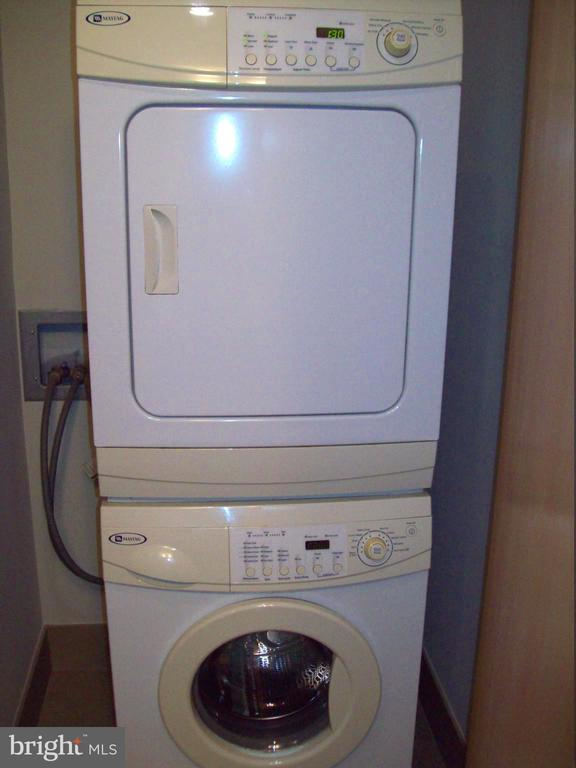 Maytag stacked washer and dryer in bathroom closet - 1133 14TH ST NW #1006, WASHINGTON