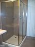 shower with procelanosa tile. - 1133 14TH ST NW #1006, WASHINGTON