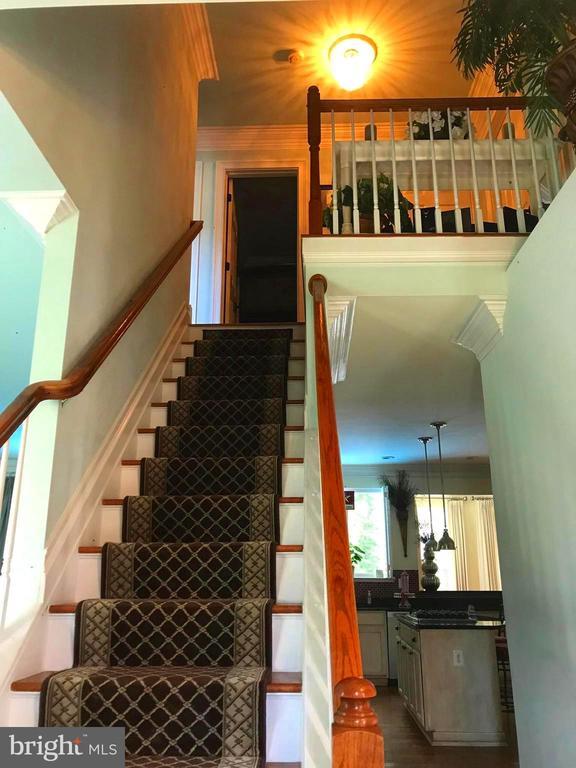 Beautiful oak handrail, wood steps to Bedrooms - 504 CREEK CROSSING LN, GLEN BURNIE