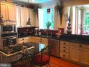 Granite counters ~ french country white cabinetry - 504 CREEK CROSSING LN, GLEN BURNIE