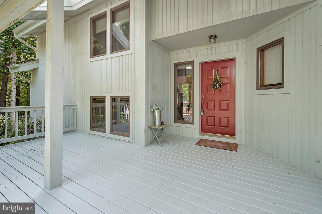 Spacious covered front porch - 10902 LAKEN WOODS DR, BUMPASS