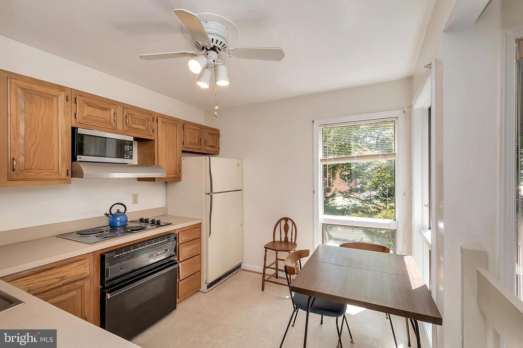 Kitchen view from hall-corner windows! - 417 LAKEVIEW PKWY, LOCUST GROVE